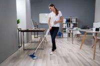 depositphotos_325534410-stock-photo-full-length-female-janitor-mopping.jpg